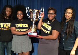Ameena Ruffin and Korey Johnson with Towson University debate team coaches
